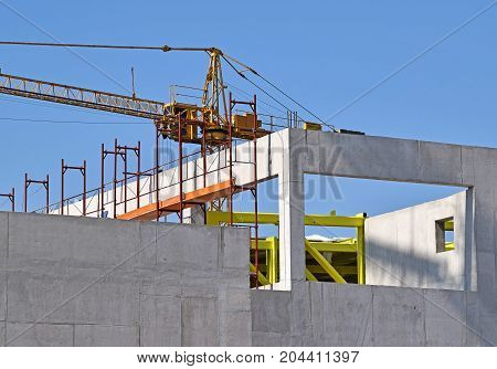 Tower crane Works at the construction of a building