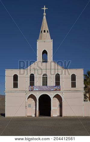 Huara, Tarapaca Region, Chile - August 21, 2017: Historic church (Iglesia Santisimo Rendentor) in the town of Huara in Tarapaca Region of northern Chile.