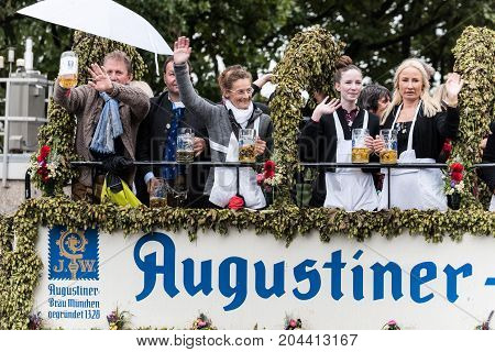 MUNICH GERMANY - 16 OCTOBER 2017: Tent owners and breweries parade at the beginning of Oktoberfest - Augustiner parade