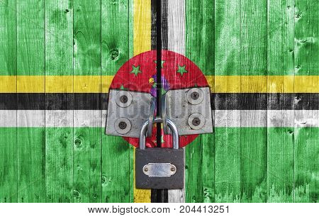 Dominica flag on door with padlock close