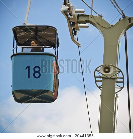 SAN DIEGO, CALIFORNIA, JUNE 11. The San Diego Zoo on June 11, 2017, in San Diego, California. A woman riding the Skyfari aerial tram on a sunny day at the world famous San Diego Zoo.