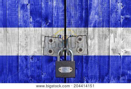 El Salvador flag on door with padlock