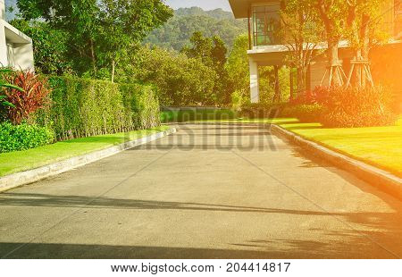 View of nice modern house in winter environment, road  with a yard on either side of a garden design,Landscape official.