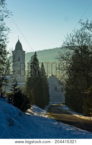 Road to monastery Beocin covered with snow at sunny winter morning, near Novi Sad, Serbia