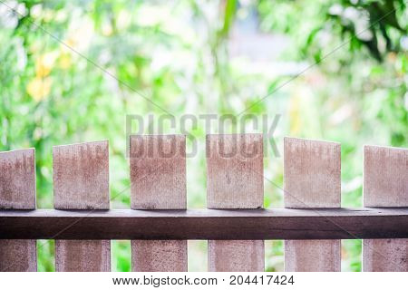 The wooden fence on the foreground and the background is nature.