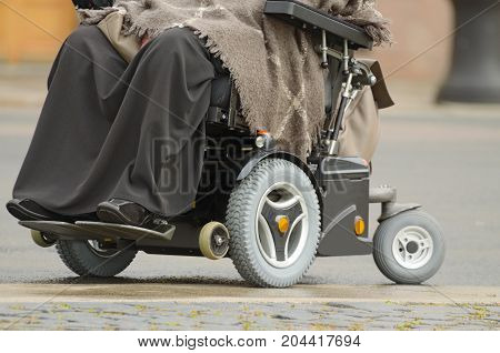 a woman in a wheelchair.Automatic chair helps her to move around.