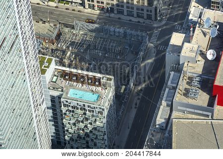 TORONTO,CANADA-AUGUST 2,2015:view of swimming pool on the top of one of the skyscrapers of Toronto view from the top of the Cn tower during a sunny day.