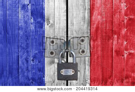 France flag on door with padlock close