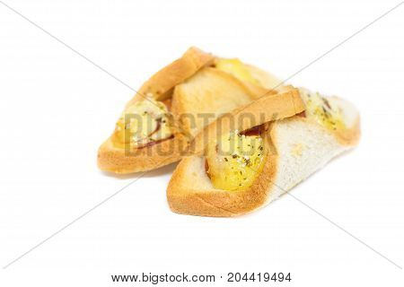 Sausage wrapped in egg bread (sandwich) with mayonnaise sauce and sprinkle little dried oregano isolated on white background - homemade food concept.