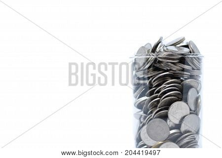 Saving money in glass for your investment future (habit) isolated on white background - saving & economical concept.