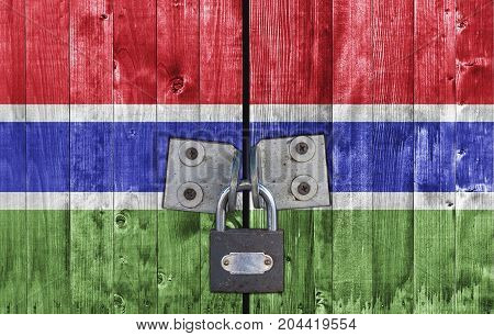 Gambia flag on door with padlock close