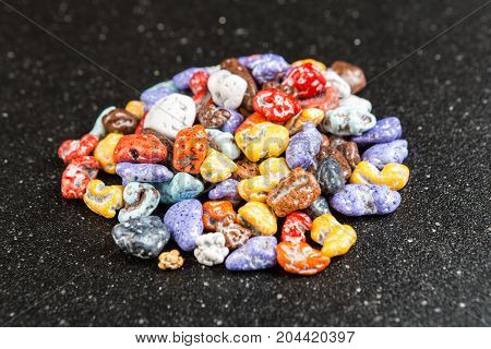 Pile Of Chocolate Rock Candy On A Black Background