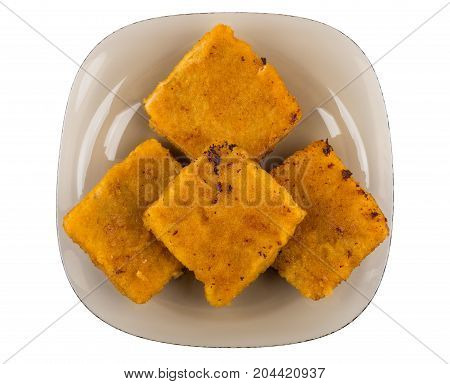 Pieces Of Fish In Breadcrumbs On Brown Plate On White
