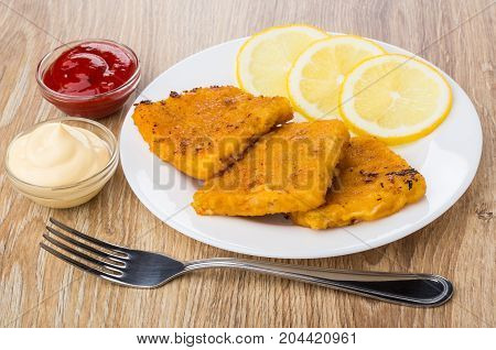 Fish In Breadcrumbs, Lemon On Plate, Ketchup, Mayonnaise And Fork