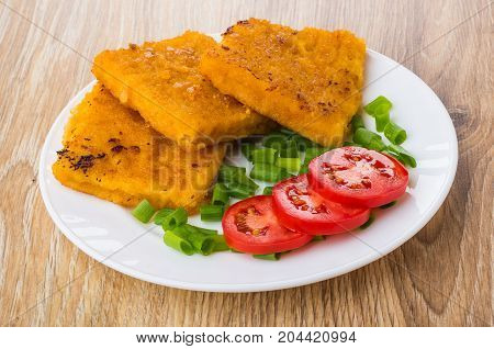 Fish In Breadcrumbs, Tomatoes, Scallion On White Plate On Table