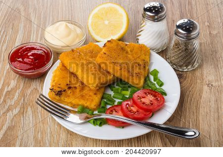 Fish In Breadcrumbs, Tomatoes, Scallion On Plate, Spices, Sauces, Lemon