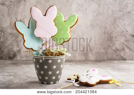 Funny easter bunnies. Gingerbread easter cookies in shape of bunny. Spring background. Space for text