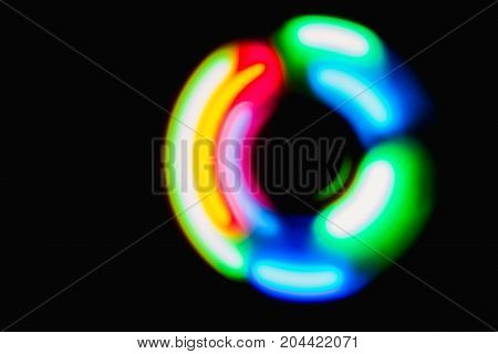 Colourful red, yellow, green sphere light in dark background