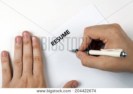 Man's hands on resume form and pen