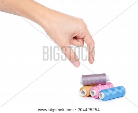 Spool Of Thread In Hand Isolated On White Background