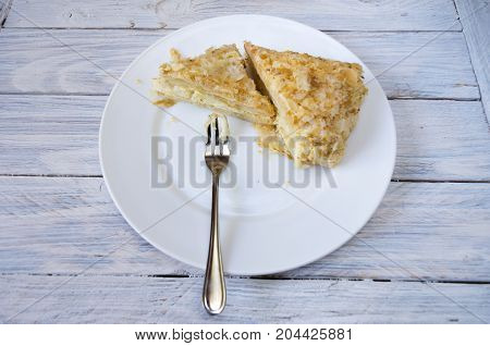 Napoleon Cake. Cake On A White Plate With A Dessert Fork.