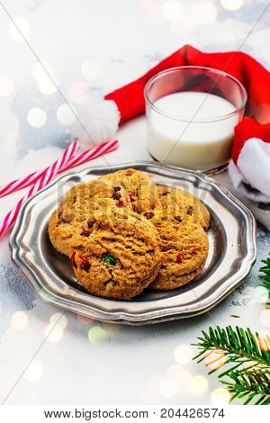 Cookies and milk for Santa on white snow background. Space for text