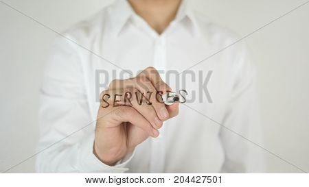 Services, Written On Glass By Man In Studio