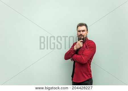 Thinking. Young Adult Bearded Businessman Touching Chin And Thinking.