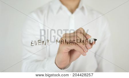 Event Management, Written On Glass By Man In Studio