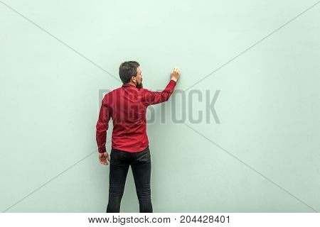 Young Adult Businessman Painting On Gray Wall