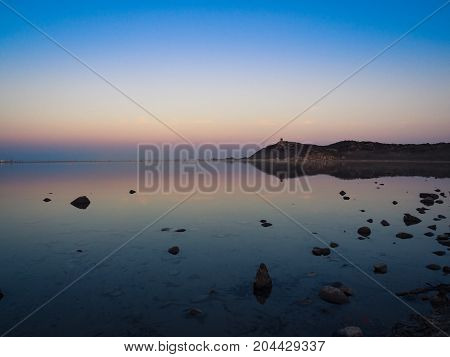 Notteri Pond famous for the presence of pink flamingos at dusk. Sardinia Italy.