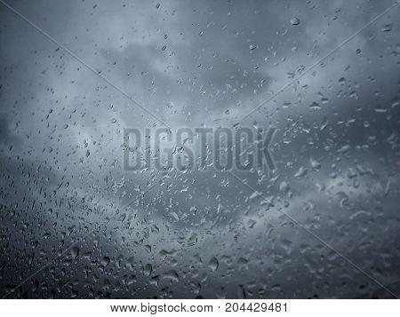 Rain Drops On Window Against Moody Sky