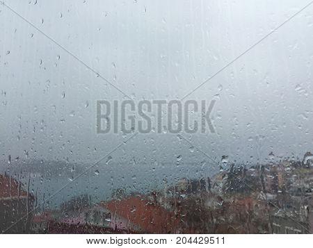 Rain Drops On Window Against Buildings In Istanbul, Turkey
