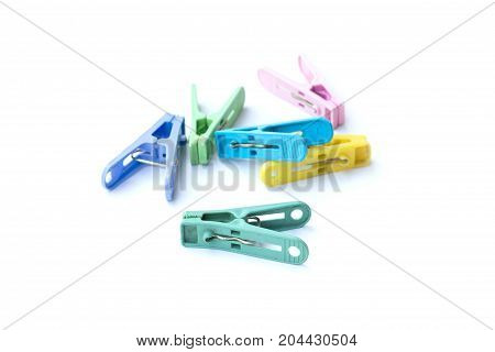Pile of colorful clothespins isolated on white background