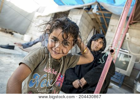 September 6, 2017, Akcakale, Turkey. Syrian people in unofficial refugee camp in Akcakale. These people are refugees from Idlib Rakka and Aleppo and escaped because of Syrian civil war. September 6, 2017, Akcakale, Turkey.
