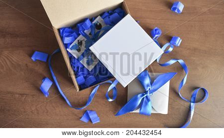 cardboard box is opened with a gift of a blue color book