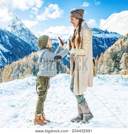 Mother And Child Travellers In Winter Outdoors Playing