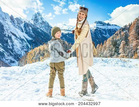Mother And Daughter Travellers Against Winter Mountain Scenery