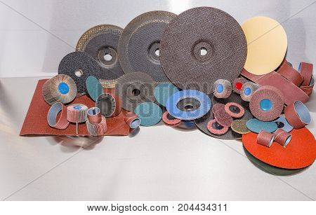 A pile of color abrasive sandpaper for metal working sandpaper for metal working