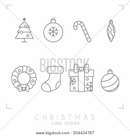 Thin line christmas icons set. Decoration ball christmas tree candy cane decoration wreath sock and gift box with snowflakes . Simple trendy design.