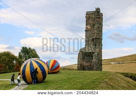 MAGDEBURG, GERMANY - September 16, 2017: Children are playing beside a climbing tower in Magdeburg with big colorful balls.