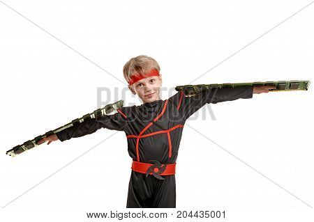 Portrait of young male ninja holding computer Memory cards