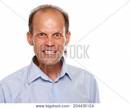 Portrait of frustrated angry young man on white background