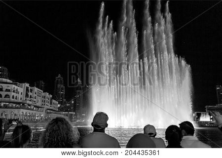 DUBAI, UAE - September 12, 2017: The Dubai Fountain is the world's second largest choreographed fountain with a breathtaking show of sights and sounds.