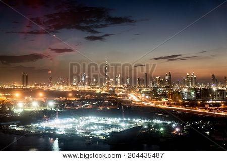 Dubai skyline and cityscape at sunset in UAE