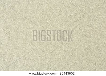 Recycled paper texture background in light cream sepia color tone. Hi res photo.