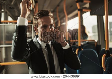 Young Businessman Talking On His Cellphone During His Morning Commute