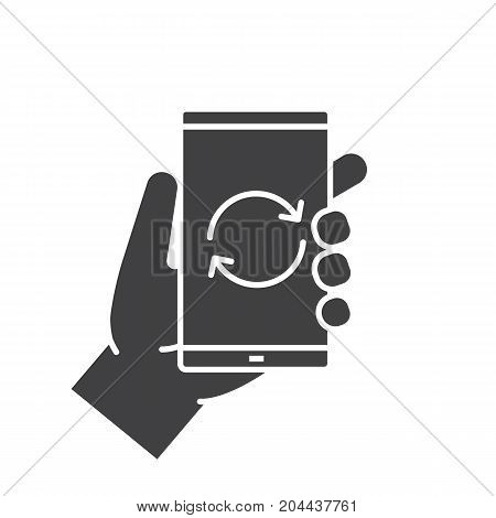 Hand holding smartphone glyph icon. Silhouette symbol. Smart phone restart. Negative space. Vector isolated illustration
