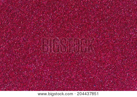 Crimson glitter background texture. High resolution photo.