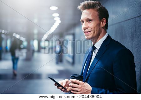 Smiling Businessman Waiting For A Subway Train Reading Text Mess